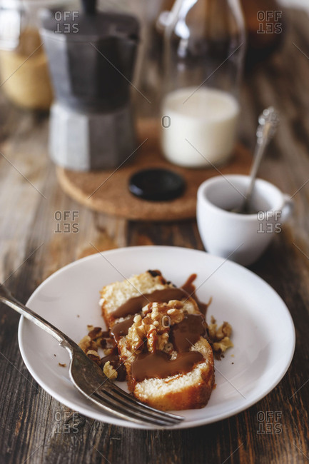 Appetizing breakfast of brioche drizzled with chocolate and an espresso