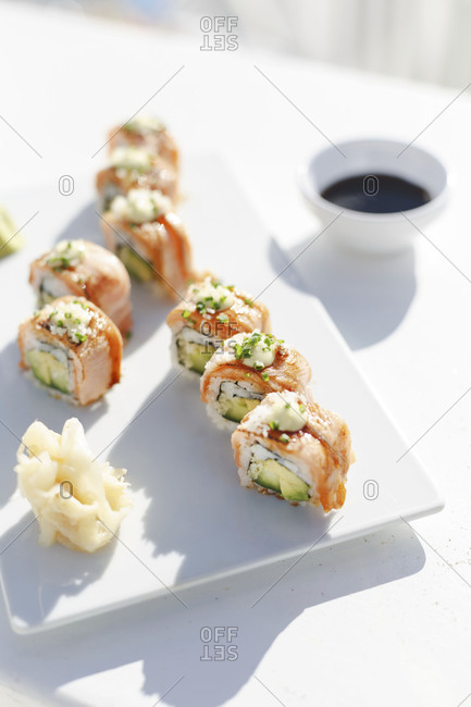 Salmon avocado sushi rolls arranged on plate