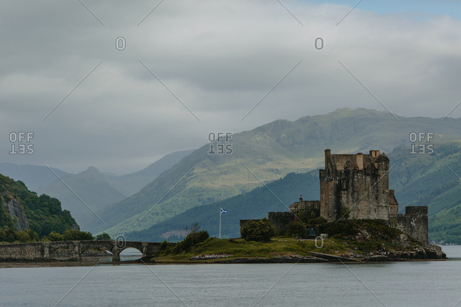 Panoramic view of island castle and lush scenery