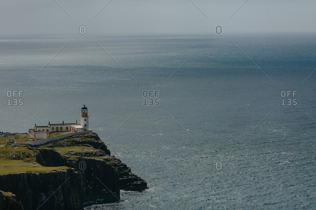 High angle view of distant lighthouse and seascape