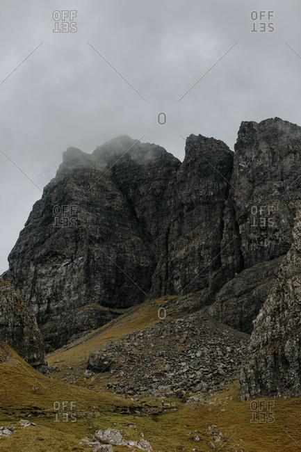 Hazy fog settling on rock formation peak