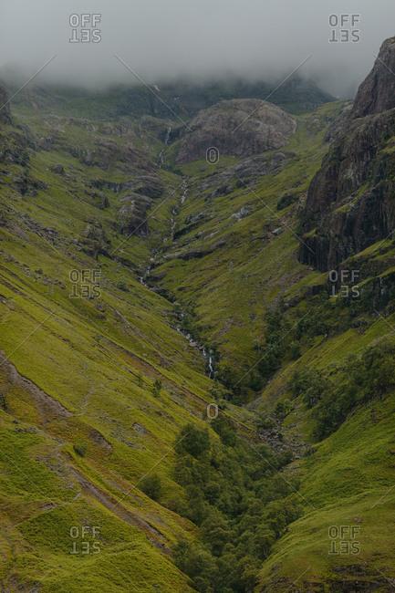 Winding stream through rocky valley