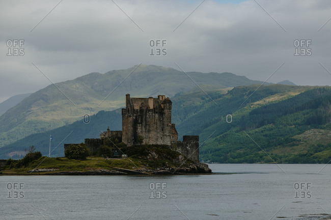 Historic castle on island in remote countryside lake