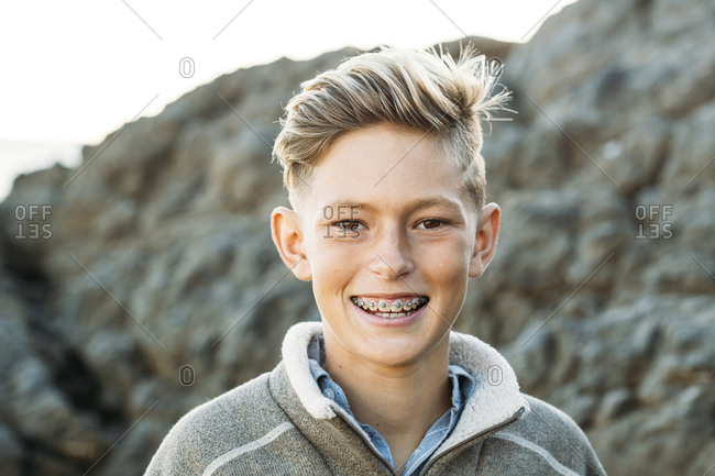Portrait of smiling boy with braces at beach