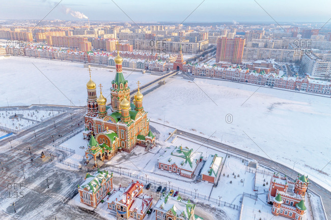 High angle view of church amidst city during winter