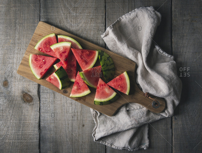 Overhead view of fresh watermelon slices on cutting board
