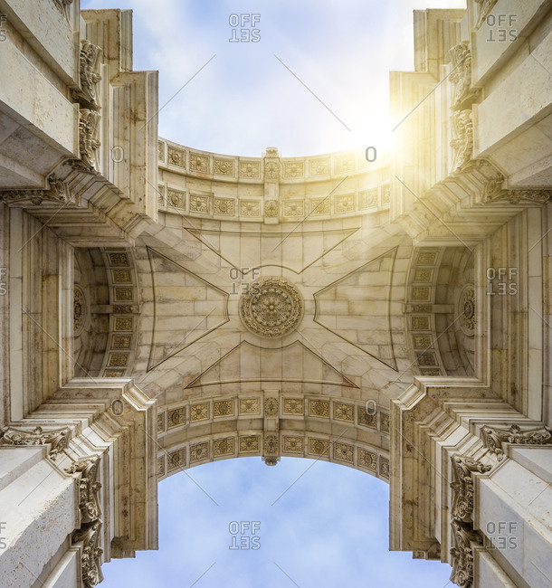 Low angle view of historic building ceiling against sky during sunny day
