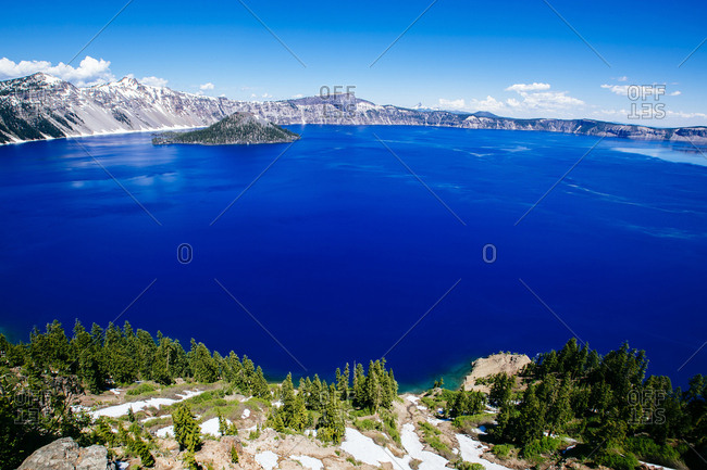 Idyllic view of Wizard Island amidst Crater Lake against sky at national park