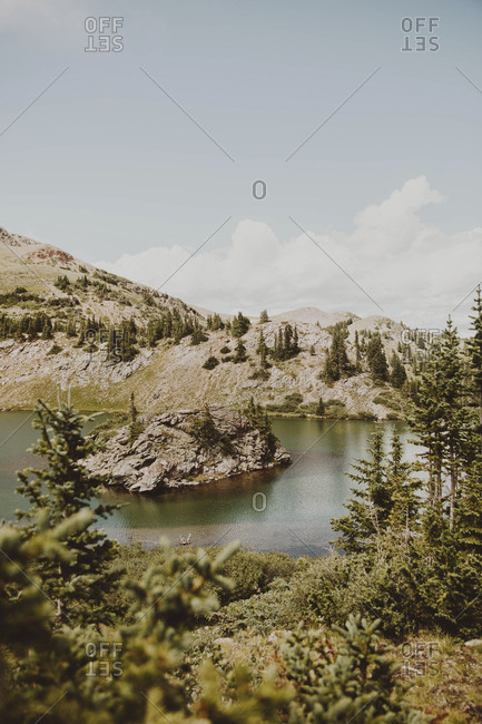 Idyllic view of lake by mountains against sky