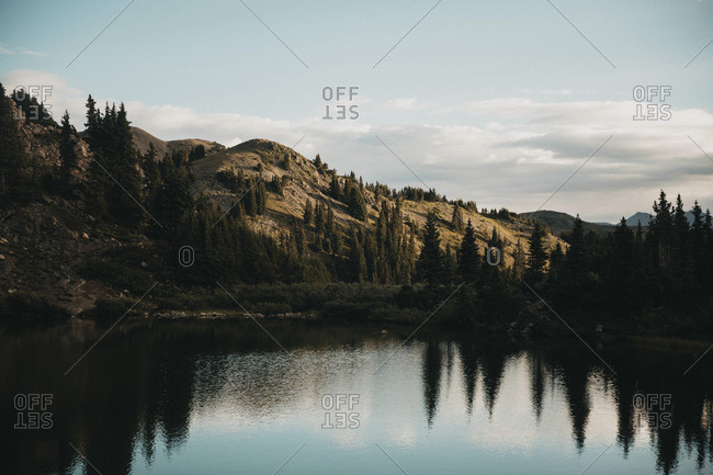 Majestic view of lake and mountains against sky