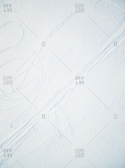 Abstract aerial view of drawings made with footprint in snow