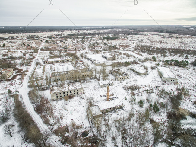 Aerial view of a deserted industrial area covering by snow in Estonia