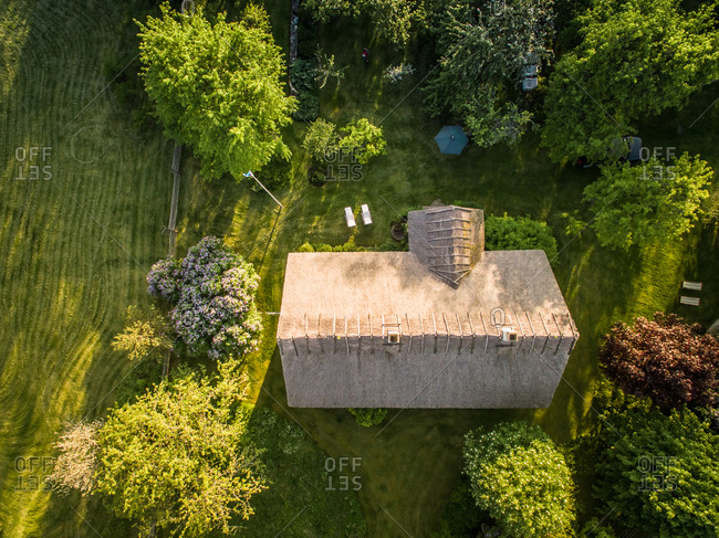 Aerial view of a house roof made with thatch in Estonia