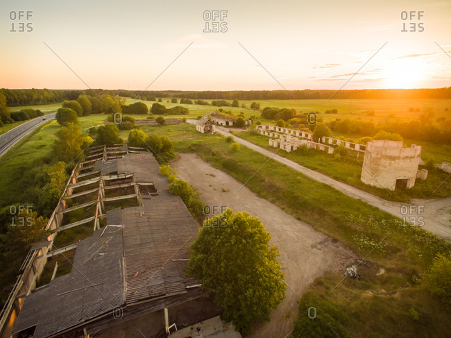 Aerial view of industrial ruins in countryside of Estonia at sunset