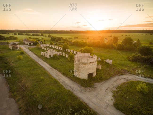 Aerial view of construction ruins in countryside of Estonia at sunset