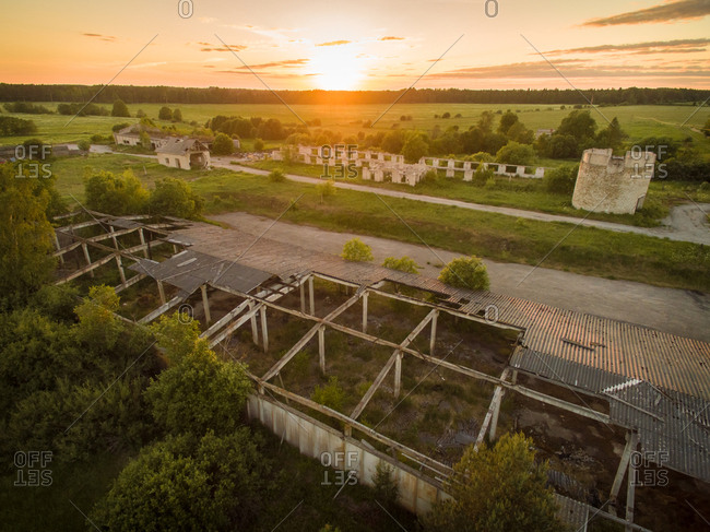 Aerial view of an abandoned warehouse in countryside of Estonia at sunset