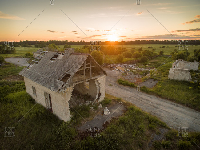 Aerial view of an abandoned house at sunset in Estonia