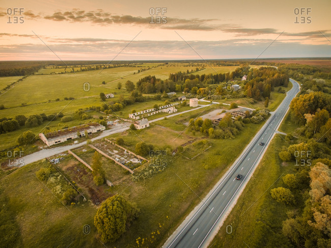 Aerial view of an abandoned farm close to the road in countryside of Estonia