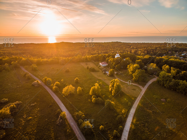 Aerial view of sunset on forest on the coast in Estonia