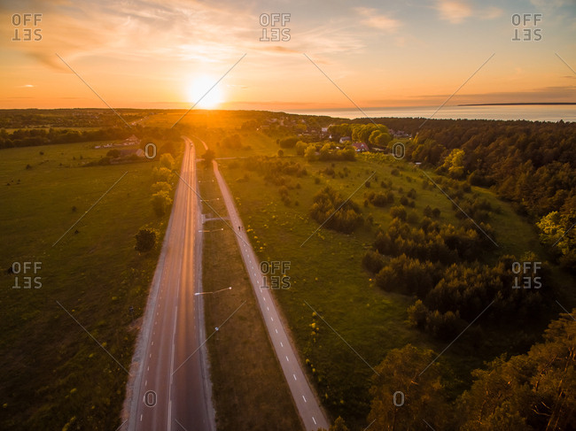 Aerial view of  empty roads in countryside at sunset in Estonia