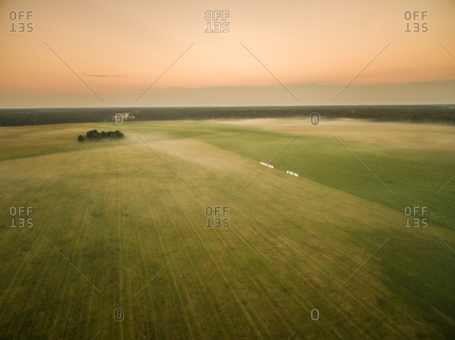 Aerial view of foggy meadow in countryside in Estonia