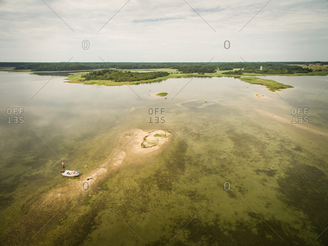 Aerial view of a family fishing on a small sand island in baltic sea in Estonia