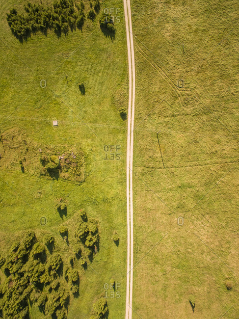 Aerial view of a en empty straight road in countryside of Estonia