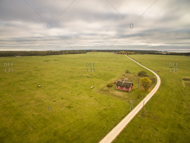 Aerial view of a traditional nordic house in farmland in Estonia