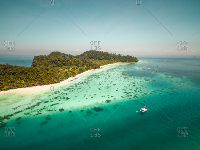 Aerial view of boats moored in the bay of Koh Rok Yai Beach island in Thailand