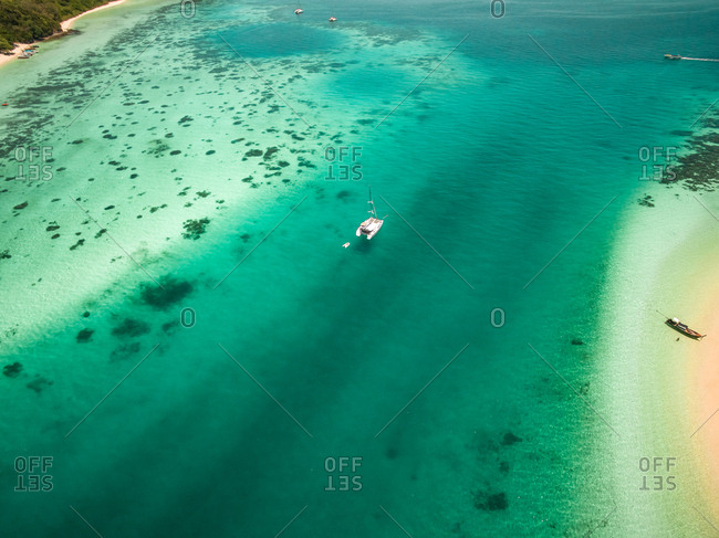 Aerial view of boats moored in the bay of Koh Rok Yai island in Thailand