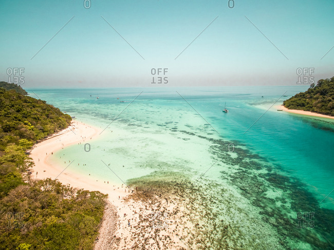 Aerial view of people swimming in sea on Koh Rok Yai island in Thailand