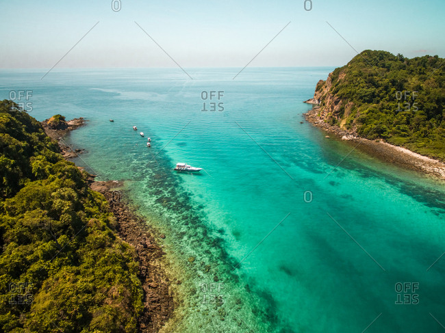 Aerial view of a yacht moored in paradisiacal bay of Koh Rok Yai island in Thailand