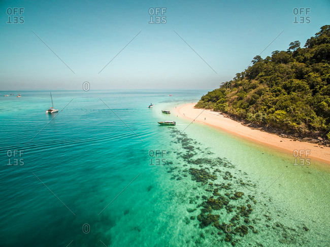 Aerial view of boats in the paradisiacal coast of Koh Rok Yai island in Thailand