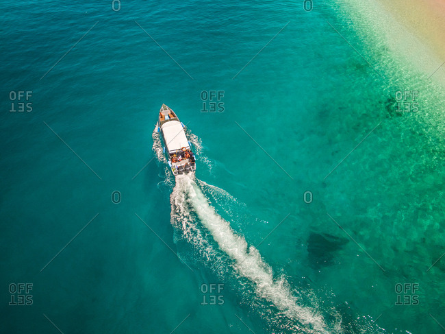 Aerial view of a traditional boat in the paradisiacal sea of Koh Rok Yai island in Thailand