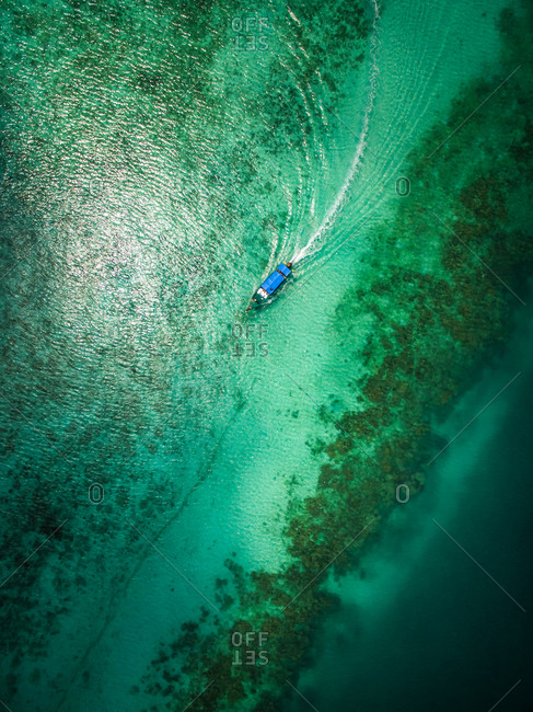 Aerial view of a boat in the paradisiacal sea in Chao Mai National Park in Thailand