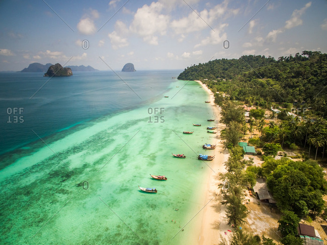 Aerial view of traditional long-tail boats moored in the bay of Chao Mai National Park in Thailand