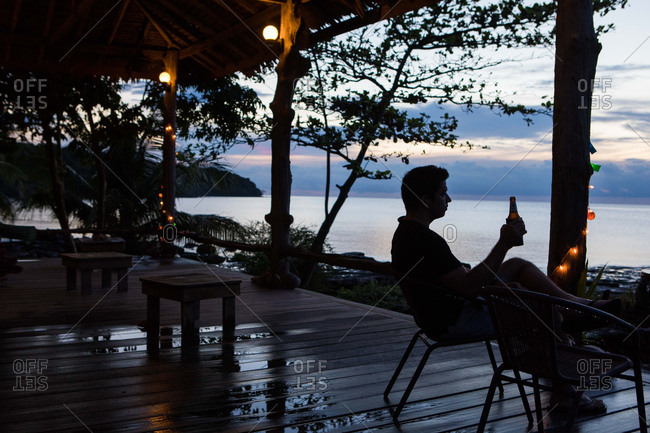 Koh Kood, Thailand - April 1, 2017: Man relaxing with beer on the island of Koh Kood, Thailand