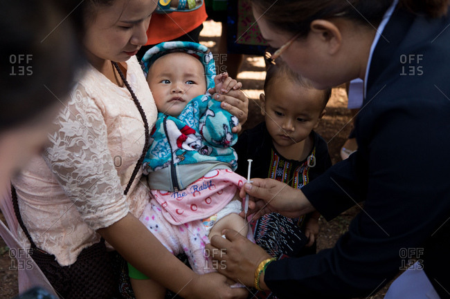 Vientiane, Laos - November 28, 2017: Vaccinations being given to baby in Nasala village outside of Vientiane, Laos