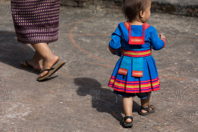 A child in local ceremonial clothing in Nasala village, Laos