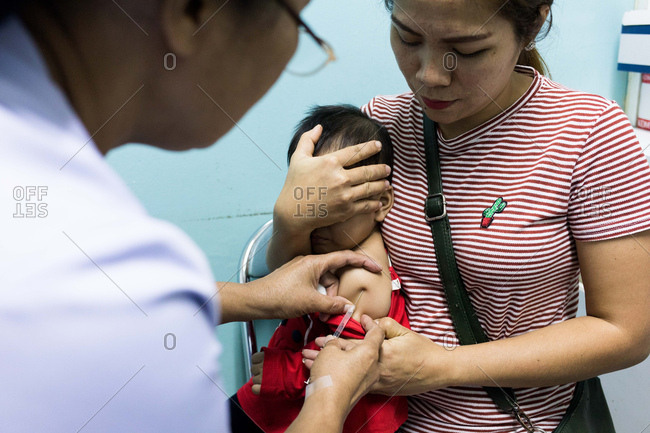 Vientiane, Laos - November 29, 2017: A baby is immunized in a local hospital outside of Vientiane, Laos