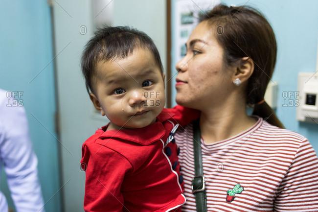 Vientiane, Laos - November 29, 2017: A baby crying after being immunized in a local hospital outside of Vientiane, Laos