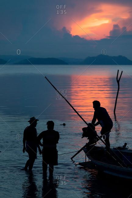 Koh Samui, Thailand - October 6, 2017: Fishermen at sunset in Koh Samui, Thailand
