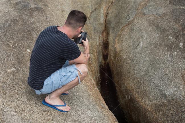 Koh Samui, Thailand - October 7, 2017: A man photographs the Hin Ta and Hin Yai Rocks in Koh Samui, Thailand