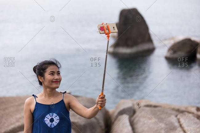 Koh Samui, Thailand - October 7, 2017: A tourist takes a selfie Hin Ta and Hin Yai Rocks in Koh Samui, Thailand