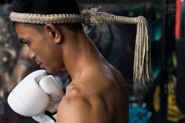 Koh Samui, Thailand - October 7, 2017: Portrait of a man practicing Muay Thai in Koh Samui, Thailand