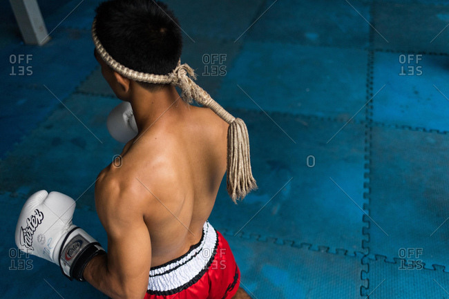 Koh Samui, Thailand - October 7, 2017: Man practicing Muay Thai in Koh Samui, Thailand