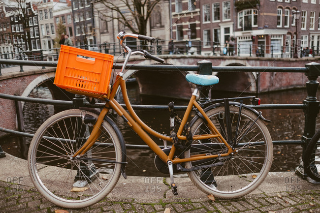 Amsterdam, Netherlands - November 17, 2017: Orange bike on canal street