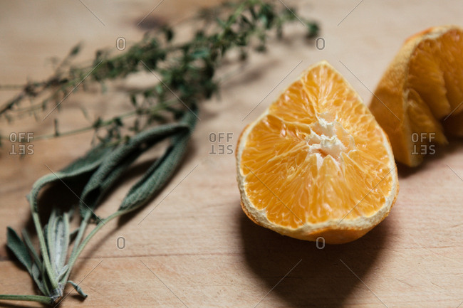 Dried orange, sage, and thyme on cutting board