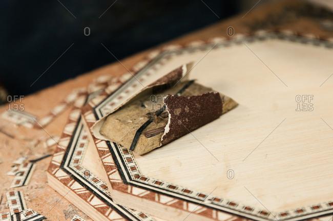 Wooden Moorish mosaic tile being finished