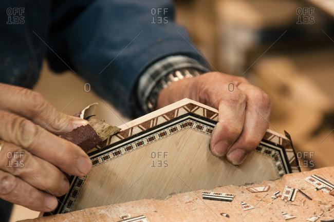 Craftsman making a wooden Moorish mosaic tile